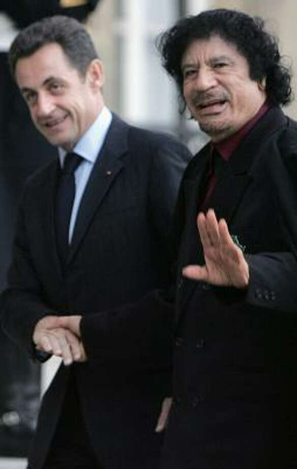 The government of French President Nicolas Sarkozy, left, said $14.7 billion worth of deals with Moammar Gadhafi is business as usual. Photo: REMY DE LA MAUVINIERE, ASSOCIATED PRESS