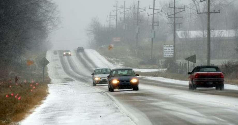 Traffic moves north of Westville, Ind., on Saturday. The winter storm is blamed for three traffic deaths. Photo: Joe Raymond, Associated Press
