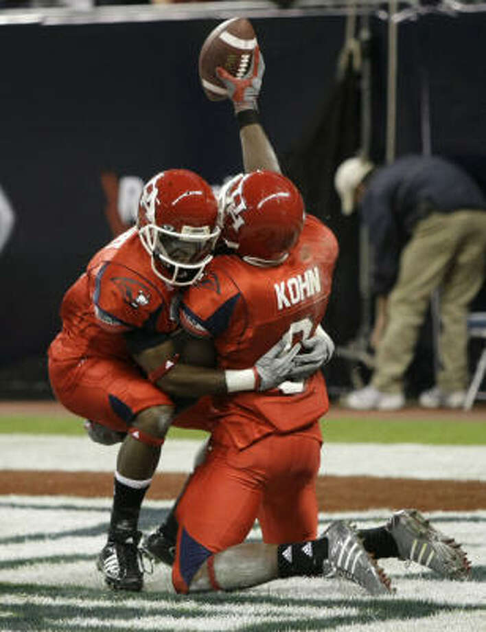 Andre Kohn (right) caught a 67-yard TD from Case Keenum in the first half. Photo: Brett Coomer, Chronicle