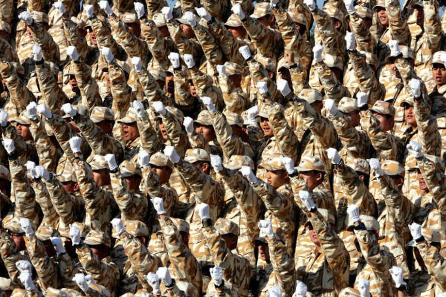 South Korean Army soldiers cheer farewell during a 2005 send-off ceremony at a military base east of Seoul. Now Washington's two top coalition partners — Seoul and London — are looking to reduce their forces in Iraq. Photo: AHN YOUNG-JOON, AP File