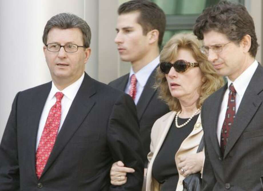 Former Qwest Communications CEO Joe Nacchio departs the federal courthouse in Denver on Thursday with wife Anne, son Michael, center back, and a lawyer. Nacchio was convicted of 19 counts of insider trading. Photo: ED ANDRIESKI, ASSOCIATED PRESS