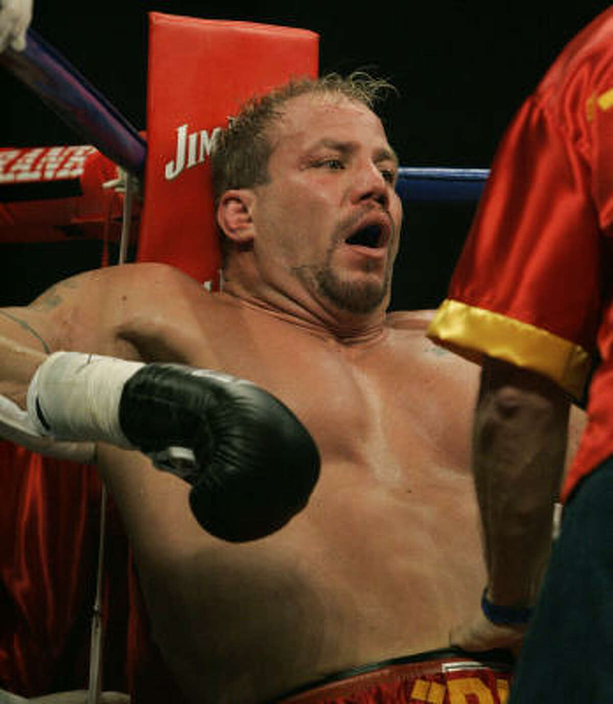 Tommy Morrison catches his breath during a victory over John Castle on Feb. 22.