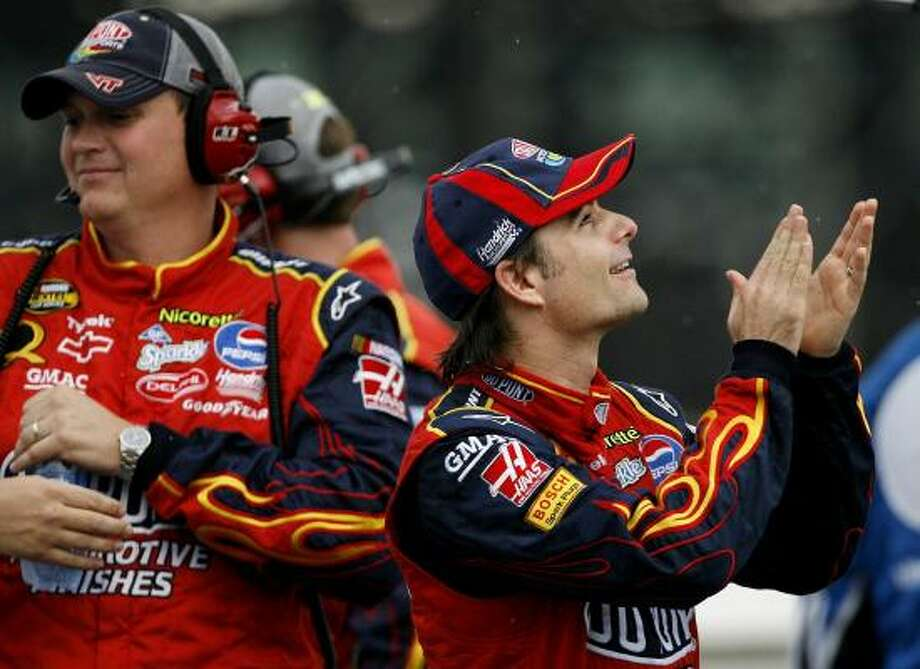 The rain keeps coming down, making Jeff Gordon, right, and crew chief Steve Letarte quite happy Sunday at Pocono. Gordon's victory marked his fourth this season in Nextel Cup races. Photo: JIM COLE, ASSOCIATED PRESS