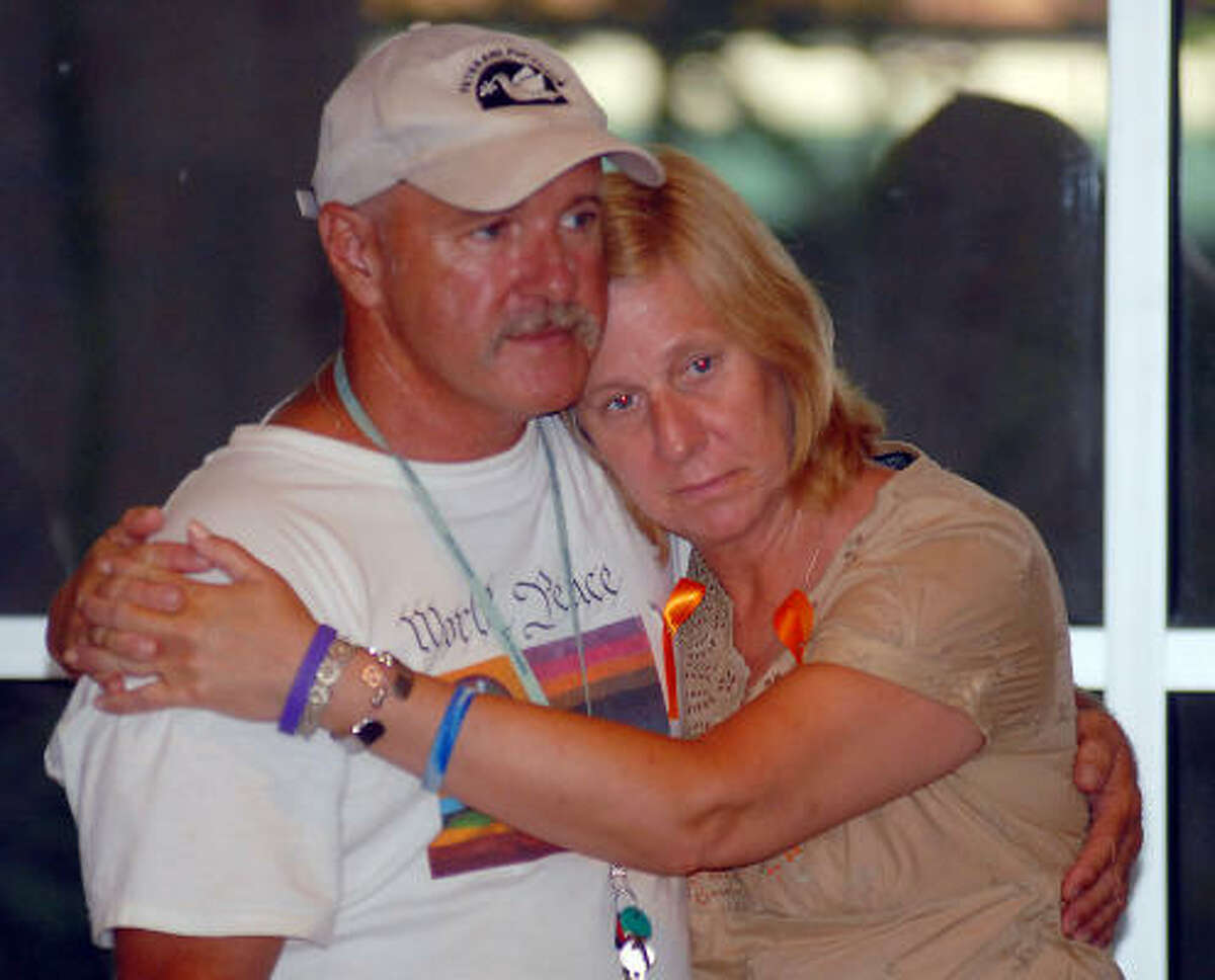 Anti-war activist Cindy Sheehan hugs Veterans for Peace member Gerry Fonseca at a rally tonight at First Unitarian Universalist Church in Houston.