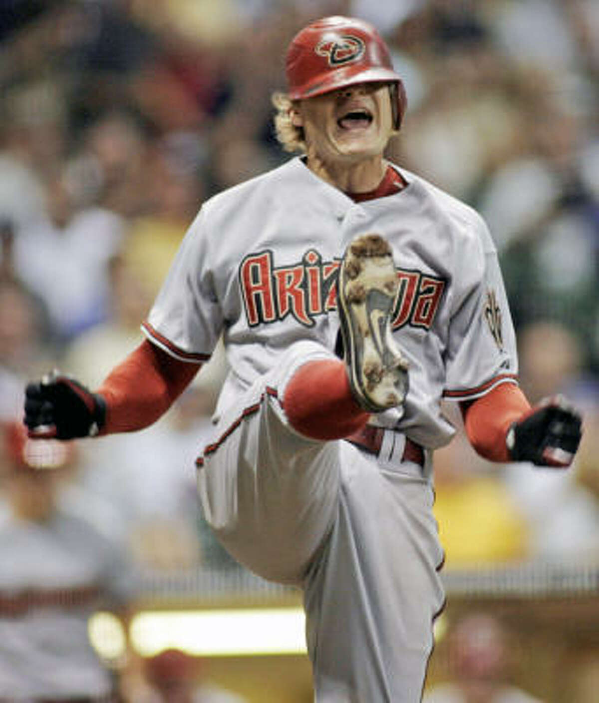 It looks like Eric Byrnes (shown after striking out against the Brewers last week) wouldn't stay with the Diamondbacks even if you dragged him to their offices kicking and screaming.