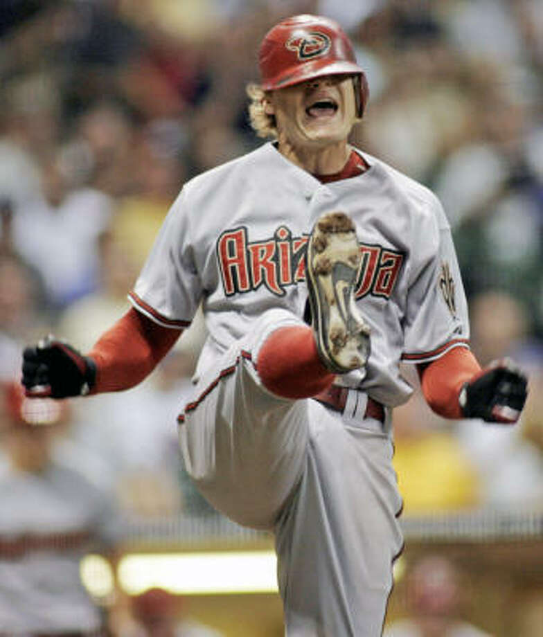 It looks like Eric Byrnes (shown after striking out against the Brewers last week) wouldn't stay with the Diamondbacks even if you dragged him to their offices kicking and screaming. Photo: Darren Hauck, AP