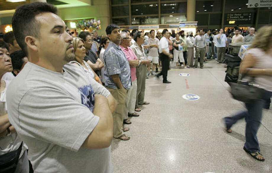 Salvador Guerrero waits for his wife to exit customs at Los Angeles International Airport on Saturday. Photo: Dan Steinberg, Associated Press