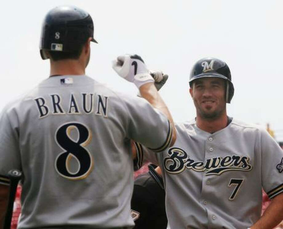 Ryan Braun, left, congratulates J.J. Hardy for a first-inning homer before hitting the third in a row by the Brewers to begin the game. Photo: TOM UHLMAN, ASSOCIATED PRESS