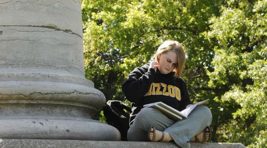 University of Missouri student Kristen Overmyer studies on campus. Overmyer did not take out enough student loans when she was a freshman and now is burdened with a heavy credit card debt. Photo: L.G. PATTERSON, AP
