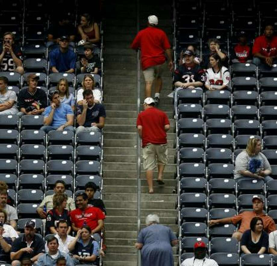Fans stream out of the stadium early in the fourth quarter Sunday, before the Texans mounted their comeback. Photo: KAREN WARREN, CHRONICLE