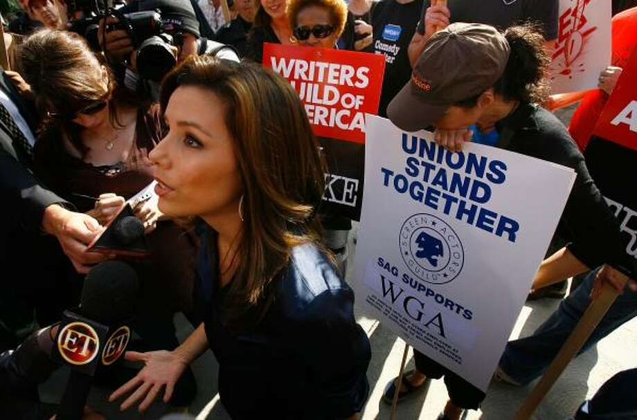 Eva Longoria speaks to the media during a break in filming as Hollywood writers picket outside the set of Desperate Housewives on Wednesday, the second day of the strike, in Los Angeles. Photo: DAVID McNEW, GETTY IMAGES