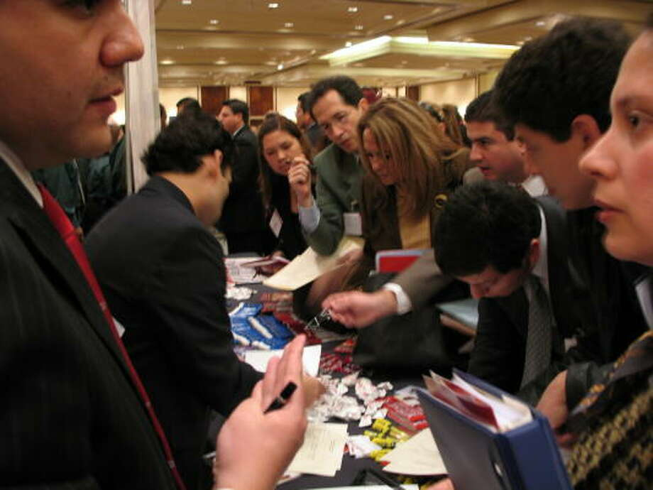 Professionals from Mexico pack an Aldine ISD recruiter's table at a Monterrey job fair. Photo: Cynthia Garza, CHRONICLE
