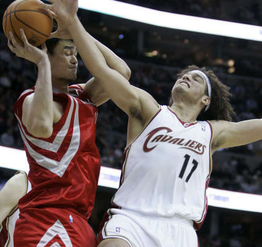 Anderson Varejao gets in Yao Ming's way. The Rockets used Yao for 27½ minutes in the center's first game back from a broken leg. Photo: Tony Dejak, AP