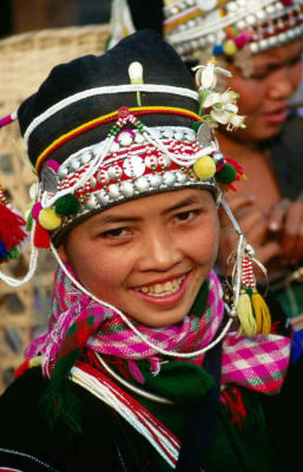 The Akha people of northern Laos welcome visitors with laughter and games Photo: Frank Carter, Lonely Planet