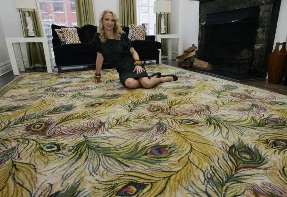 The fashion designer, known for her retro-inspired separates and dresses, designed a peacock-themed carpet that she liked enough to install in her own home in New York's Greenwich Village. Photo: RICHARD DREW, ASSOCIATED PRESS