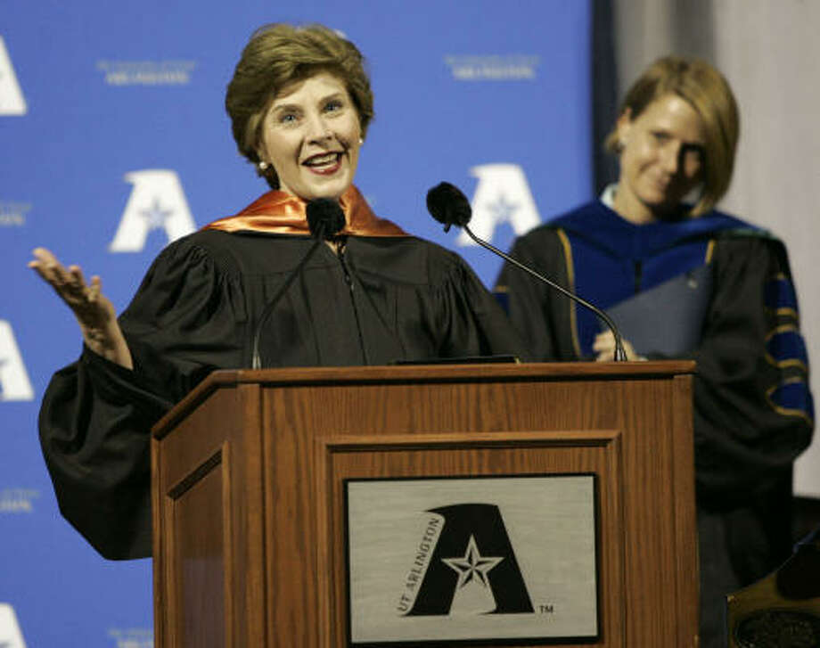 First lady Laura Bush addresses University of Texas at Arlington graduates Friday night in Arlington. At right is Provost Dana Dunn, vice president for Academic Affairs. Photo: Tony Gutierrez, AP