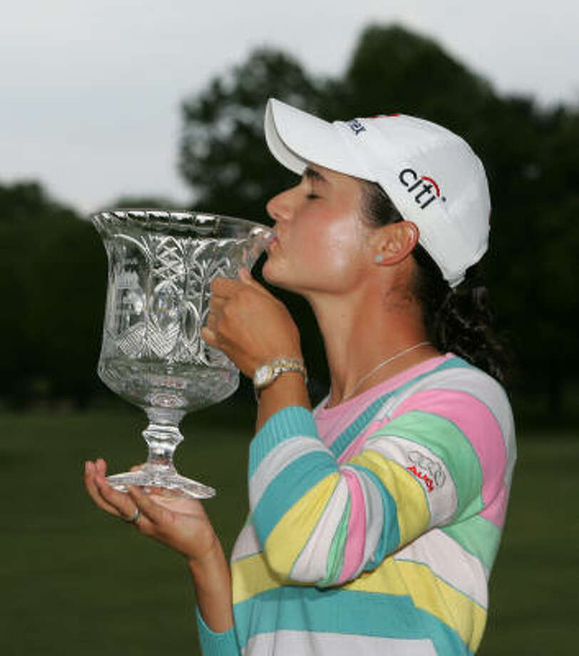 Lorena Ochoa has a moment with her new trophy after winning the LPGA's Sybase Classic on Sunday. Photo: Mel Evans, AP