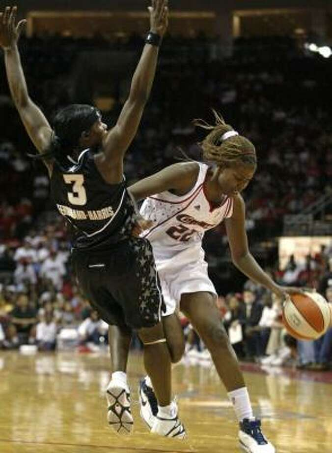 The Comets' Sheryl Swoopes, who failed to score in double figures for the second game in a row, gets called for a charge after running into Marie Ferdinand-Harris. Photo: JESSICA KOURKOUNIS, FOR THE CHRONICLE