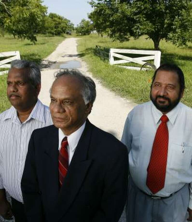 Somarajan Nair, left, Sam Kannappan, center, and Sasidharan Nair plan to build an independent- and assisted-living community in Pearland. Photo: KAREN WARREN, CHRONICLE