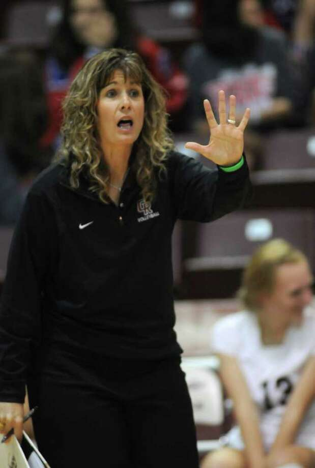Cinco Ranch head coach Tammy Laurence pumps up her team against Kingwood. Photo: Jerry Baker, Freelance / Freelance