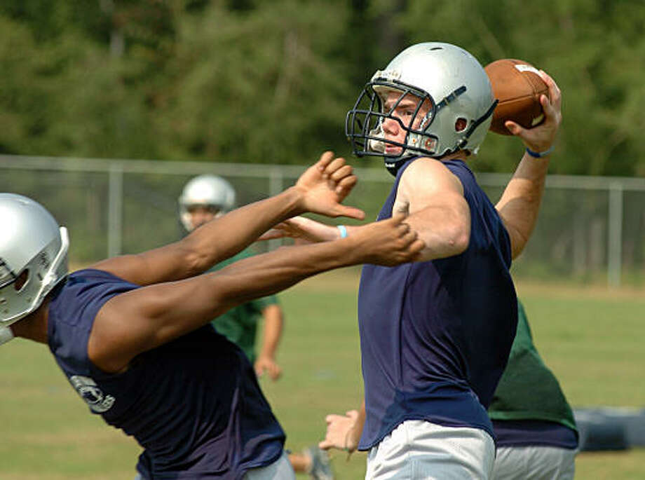 Quarterback Josh Parsins passes the ball during the College Park High School football practice. Photo: David Hopper, For The Chronicle
