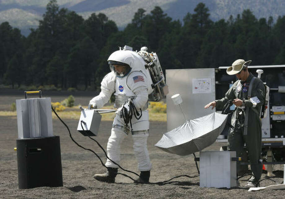 Space suit engineer Dustin Gohmert tests a concept lunar space suit at NASA's Desert RATS  facility at Cinder Lakes, near Flagstaff, Ariz. Photo: James Nielsen, Chronicle