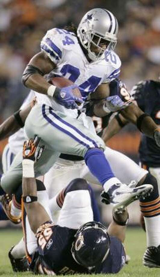 Dallas' Marion Barber literally runs over Chicago's Lance Briggs during the Cowboys' 34-10 win Sunday night. Photo: NAM Y. HUH, ASSOCIATED PRESS