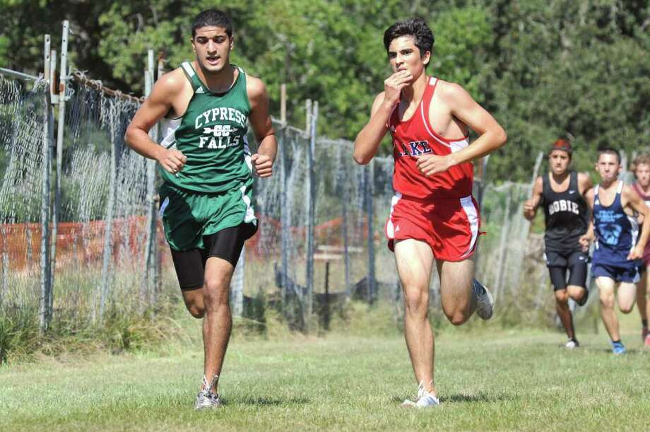 Paul Yacoub, left, is one of the top runners for the Cy Falls boys in the 2010 cross country season. He's pictured here with Clear Lake's Jeremiah Santos on 10-8-10 in Seabrook. Photo: L. Scott Hainline / freelance