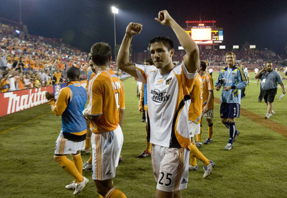 Brian Ching, as he often does, gave Houston reason to celebrate after their playoff series against FC Dallas. Photo: Smiley N. Pool, Chronicle