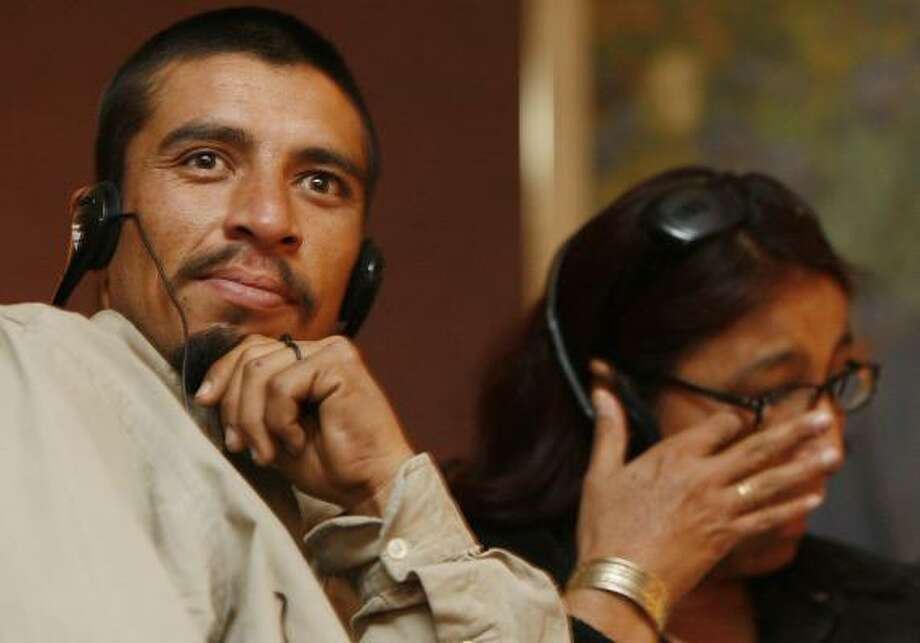 As his mother, Alma Lidia Soberanes, wipes away tears, Manuel Jesus Cordova Soberanes watches a presentation honoring his heroism in Nogales, Ariz. Photo: JEFFRY SCOTT, ARIZONA DAILY STAR