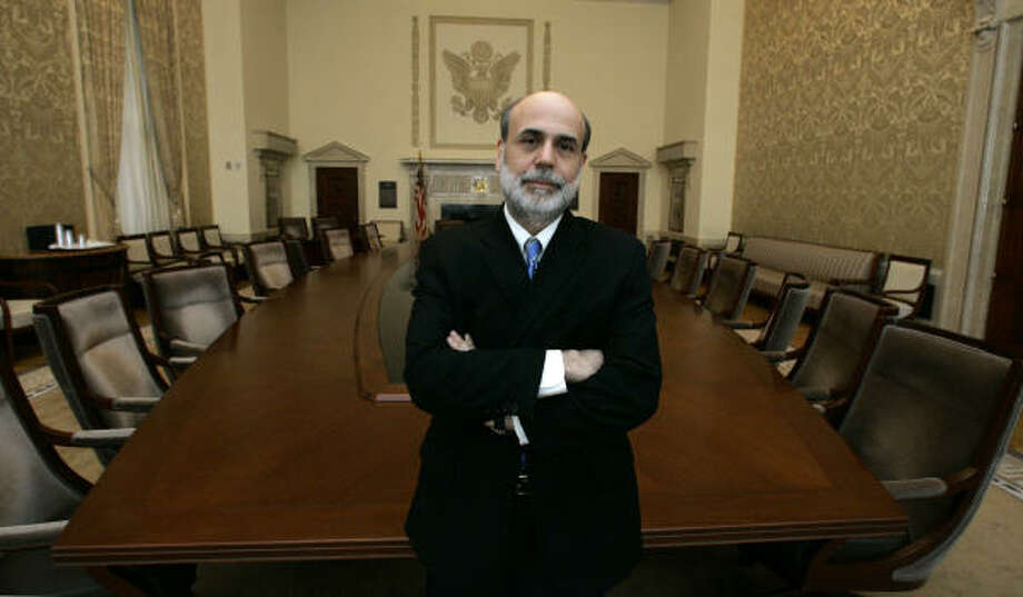 Federal Reserve Board Chairman Ben Bernanke poses in the board room of Federal Reserve headquarters. Photo: MANUEL BALCE CENETA, AP