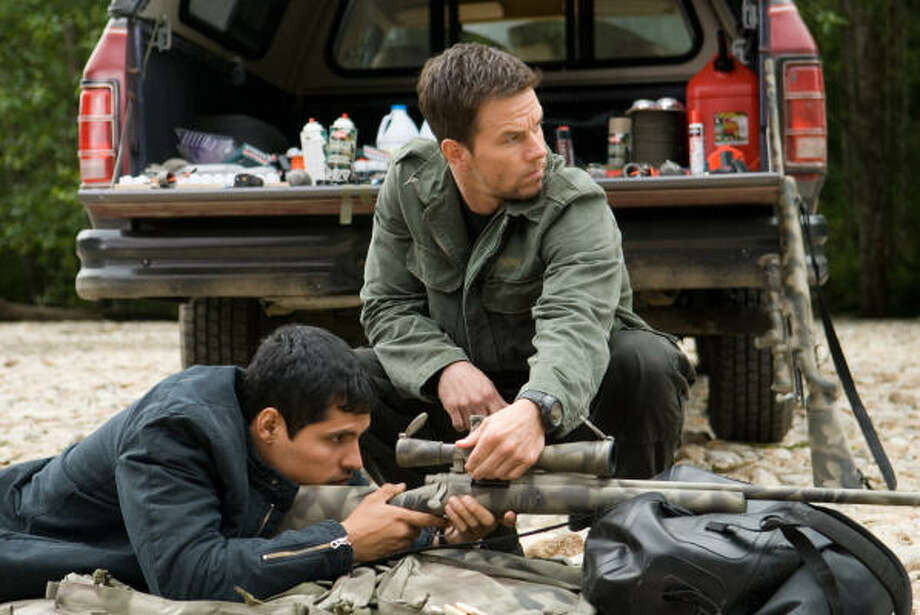 Wahlberg (with Michael Peña, left) is wary not to be pigeon-holed. He plans on moving away from action films, and already in the can is We Own the Night, a family drama. Photo: Kimberley French, Paramount Pictures