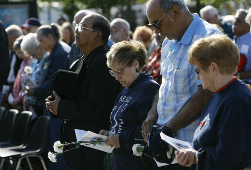 April 16, 2008: Pye Zaragoza,  left, his wife, Mary Zaragoza, Francisco Garcia and his wife, Jeannette Garcia, right, reflect during a ceremony marking the 60th anniversary of the 1947 Texas City disaster at Memorial Park in Texas City. Photo: Melissa Phillip, Houston Chronicle