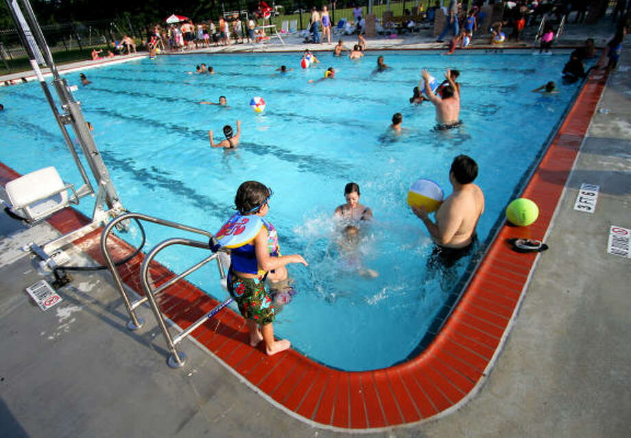 Area residents celebrate the grand re-opening of the Westbury pool. Photo: Jason Brown, For The Chronicle