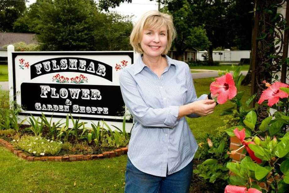 B.J. Yewens and husband Harry sold their golf course in 2005 and opened Fulshear Flower and Garden Shoppe. She says most of the business involves hard manual labor. Photo: BOB LEVEY, FOR THE CHRONICLE