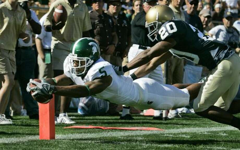 Michigan State wide receiver Devin Thomas scores in front of Notre Dame cornerback Terrail Lambert to help the Spartans hand Notre Dame its fourth loss of the season. The Irish have allowed at least 30 points in each game. Photo: MICHAEL CONROY, ASSOCIATED PRESS