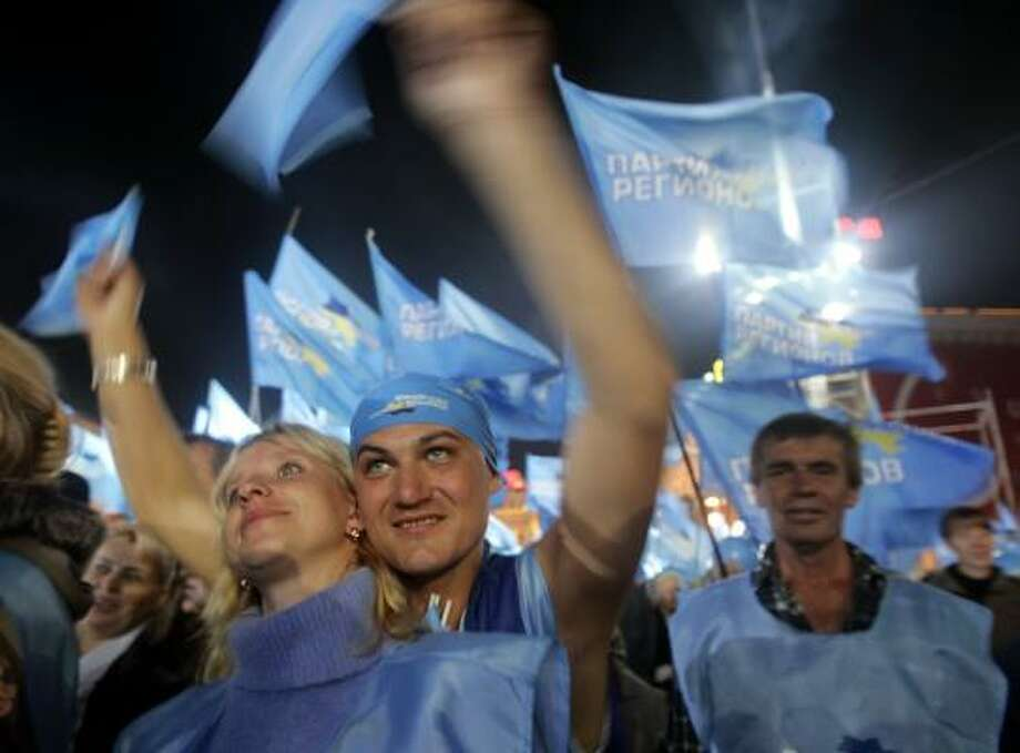 Supporters of Ukrainian Prime Minister Viktor Yanukovych greet  their leader during a massive rally on Independent Square in Kiev, Ukraine, Friday, Sept. 28, 2007, on the last official day of political campaigning, ahead of the parliamentary election on Sunday.  (AP Photo/Efrem Lukatsky) Photo: EFREM LUKATSKY, ASSOCIATED PRESS