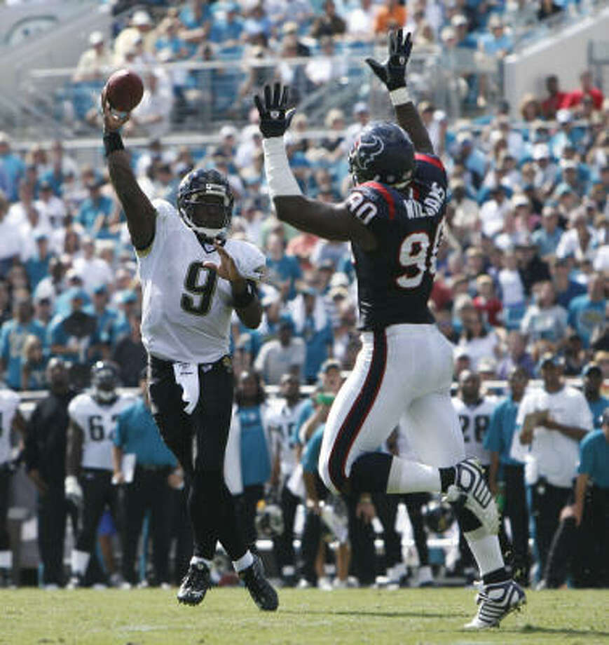 The Texans, with Mario Williams (90), gave up their most points yet in the Jacksonville series. Photo: James Nielsen, Chronicle