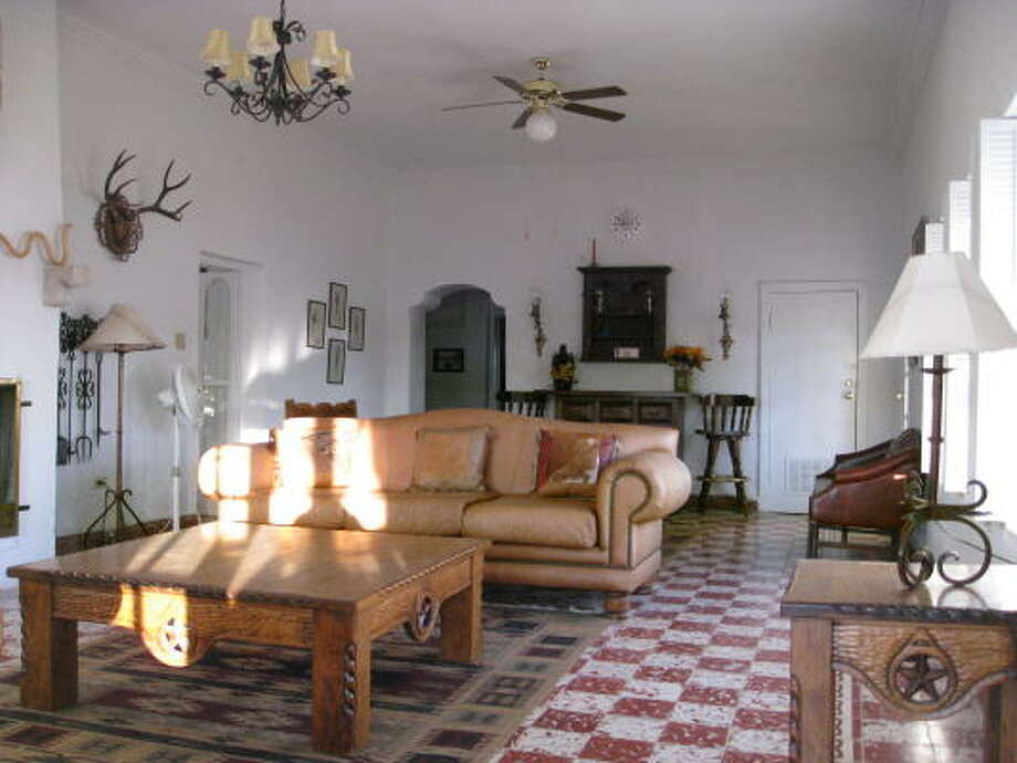 Leather, heavy wood and wrought iron toughen up the look of the living space at the Sauceda Big House, one of Big Bend Ranch State Park's few comfort zones. Photo: Louis B. Parks, CHRONICLE