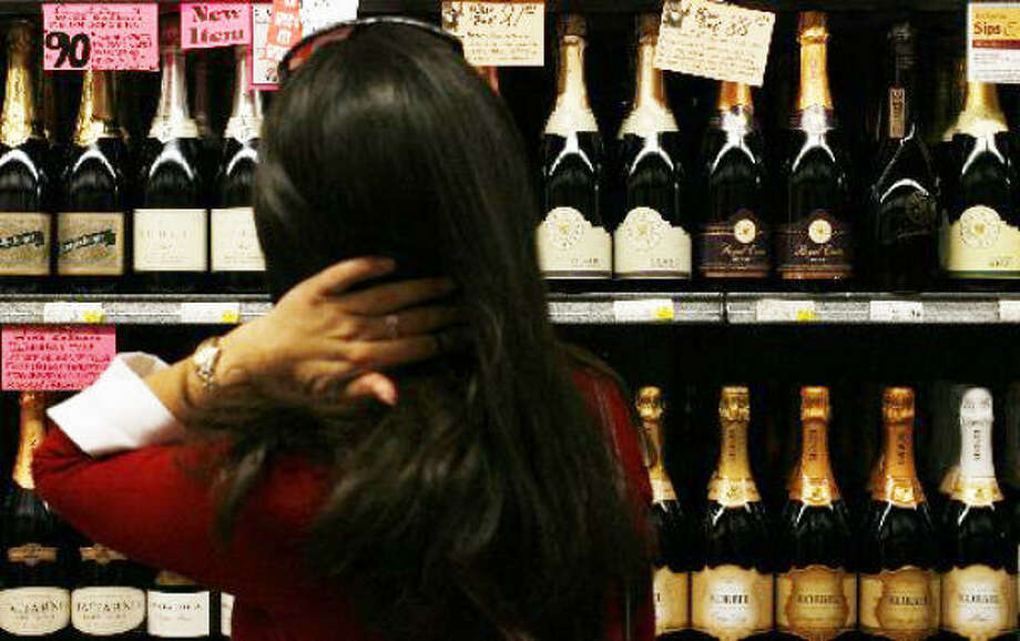A customer shops in the champagne aisle at Spec's Wines, Spirits & Finer Foods on Saturday in Houston. Photo: Sharon Steinmann, Chronicle