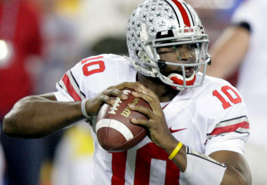 Former Ohio State quarterback Troy Smith would like to trade his silver and red helmet for an orange one in April. Photo: Paul Connors, AP