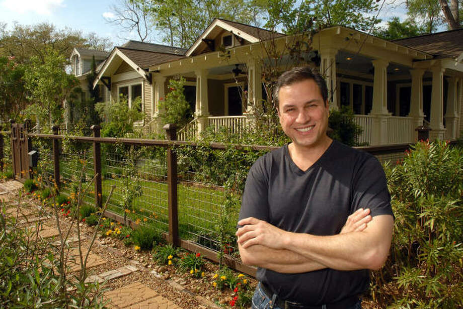 Gilbert Perez shows off two bungalows he restored on 14th Street. He is renovating his seventh bungalow in the Heights. Photo: Dave Rossman, For The Chronicle