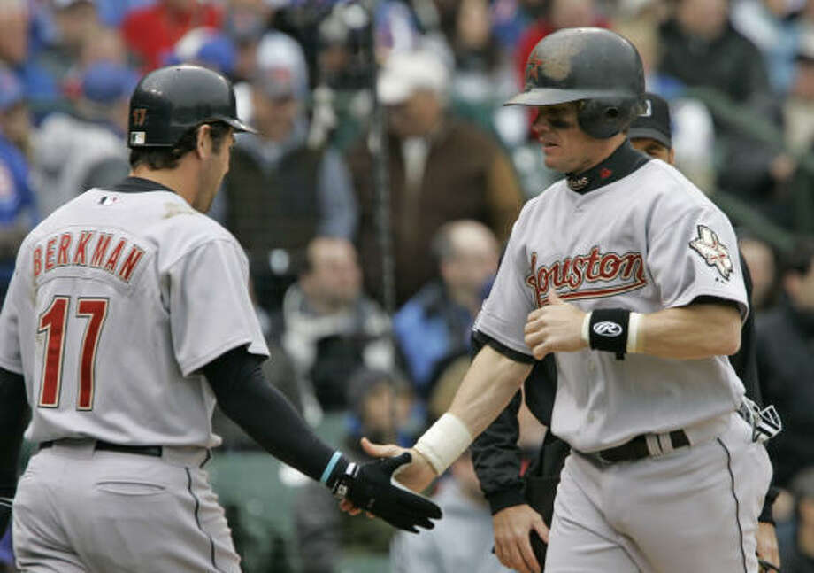 Houston's Craig Biggio is congratulated by Lance Berkman after Biggo scored on a double by Chris Burke. Photo: M. Spencer Green, AP
