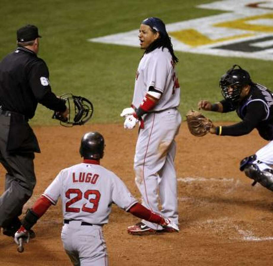 Boston's Manny Ramirez argues being called out on a tag by Yorvit Torrealba, right, of the Rockies during Game 3 on Saturday in Denver. Photo: ROBERT CAPLIN, BLOOMBERG NEWS