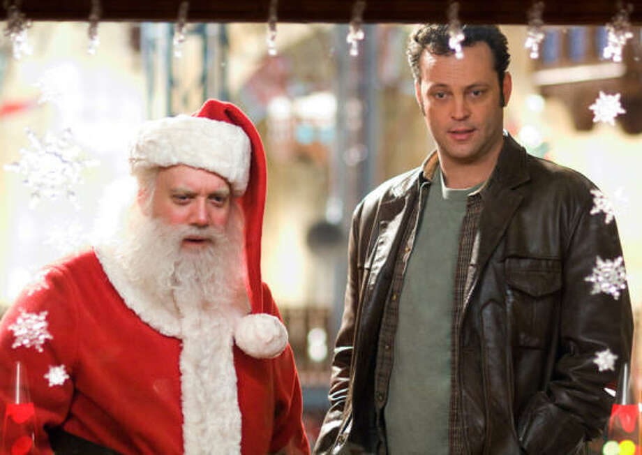 Paul Giamatti, as Nick Claus, and Vince Vaughn as his brother, Fred, in the holiday comedy Fred Claus. Photo: Warner Bros