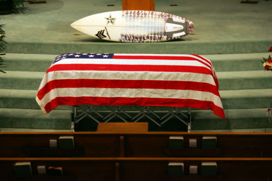 The casket holding 21-year-old Lance Cpl. Stephen L. Morris'  sits in front of a surfboard at the First Baptist Church in Lake Jackson before his funeral, today. Photo: Johnny Hanson, For The Chronicle