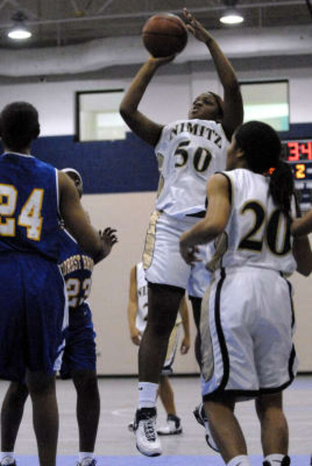 Nimitz' Arielle Thomas shoots for two after securing an offensive rebound against Forest Brook. The Cougars face Aldine on Friday. Photo: Kim Christensen, For The Chronicle