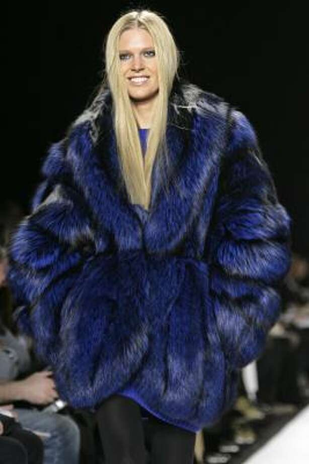 A huge royal-blue mink engulfs a model during the showing of Michael Kors' 2007 fall collection. Photo: KATHY WILLENS, ASSOCIATED PRESS