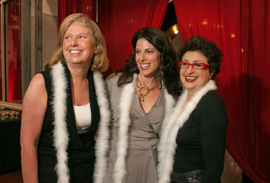 """With $250,000 in proceeds from the Bo's Place """"Girls Night Out"""" event, chair Charla Wilson, from left, honorary chair Suzanne O'Donnell and vendor chair Roz Pactor had plenty of reasons to grin. Photo: Gary Fountain, For The Chronicle"""
