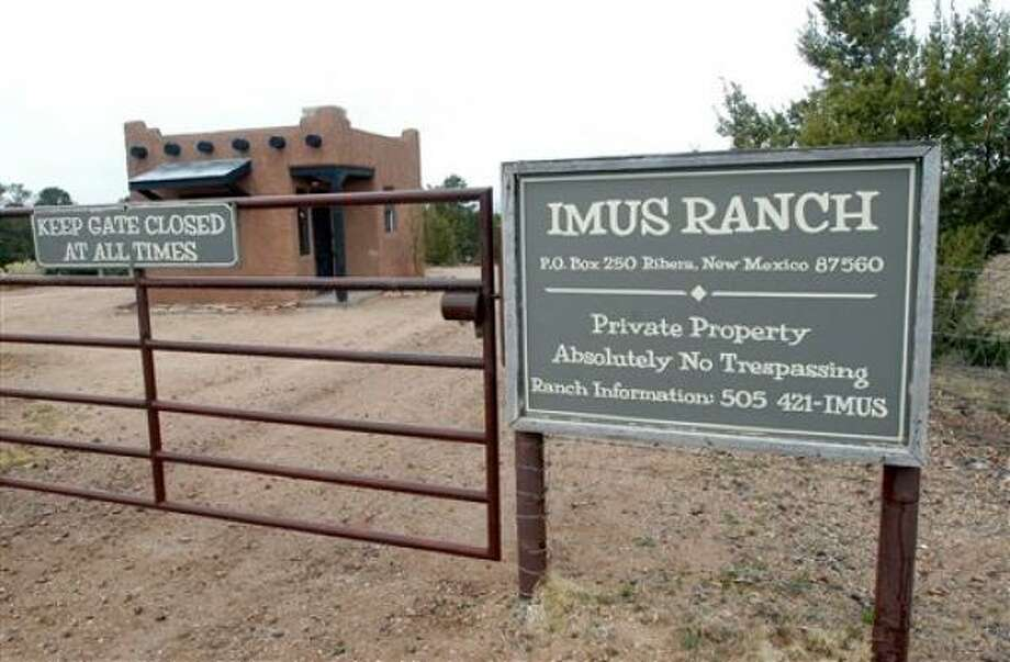 The entrance to the Imus Ranch, owned by radio personality Don Imus is shown in Ribera, N.M., on Thursday. Imus's banishment from the public airwaves deprives him of a critical platform to raise money for the camp. Photo: Jeff Geissler, AP